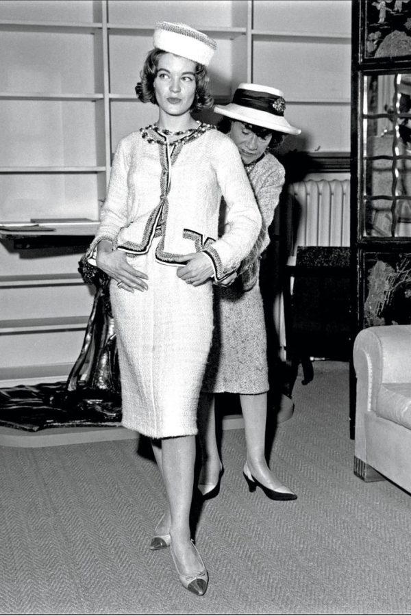 The iconic Chanel suit with a pillbox hat